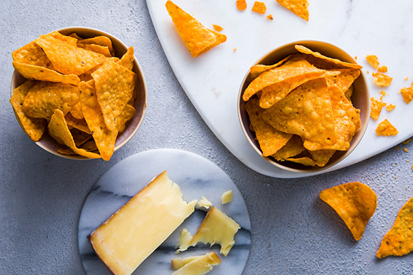 bowls of cheese flavoured tortilla chips