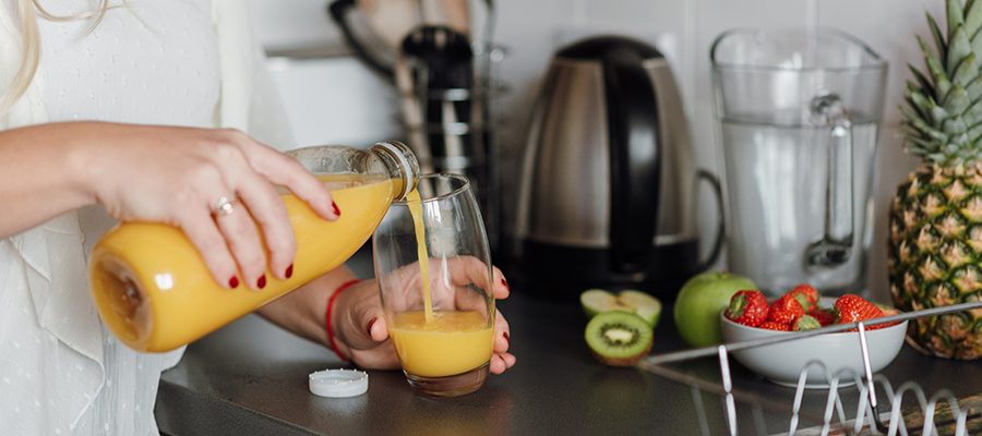 woman pouring beverage with functional immune ingredients