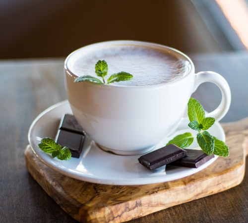 hot beverage in mug with mint and chocolate