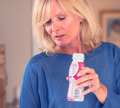 woman drinking nutritional beverage