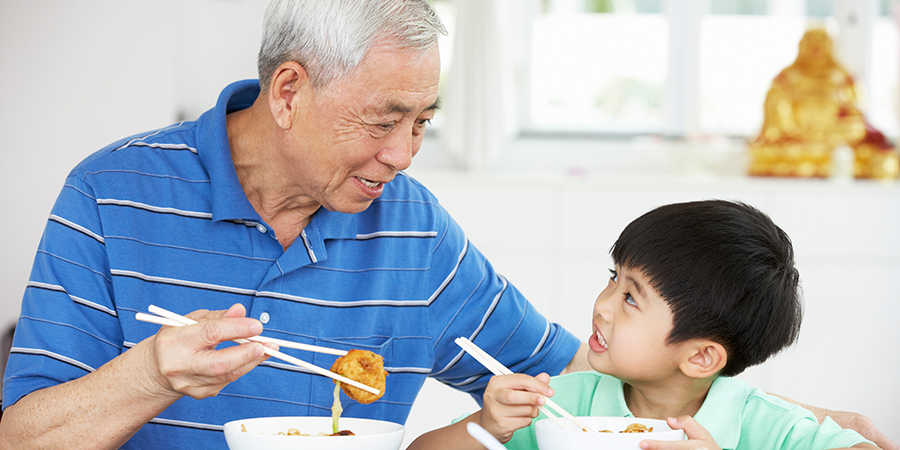 grandfather eating with grandson
