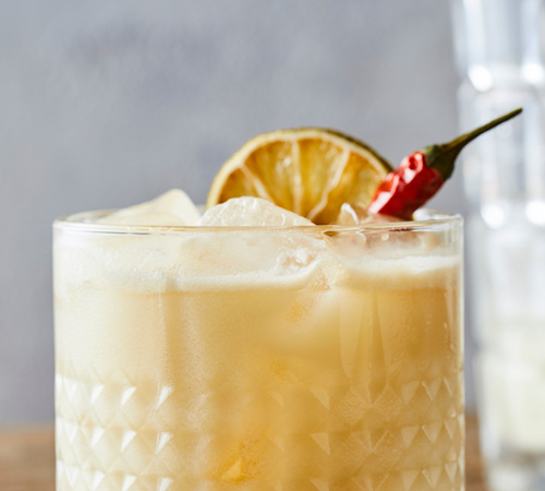 whiskey cocktail with citrus and pepper